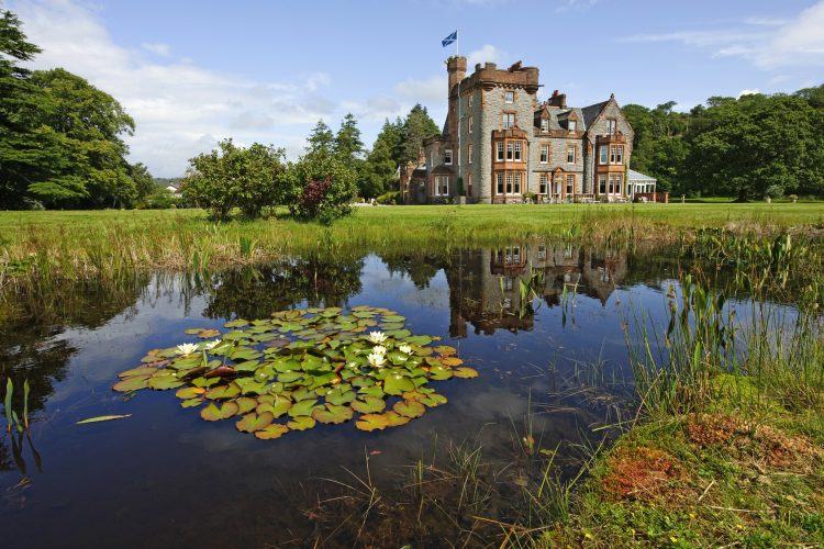 Castle Hotel with lake and lily ponds in foreground